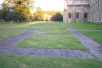 The site of the Old Minster is outlined in brick in the grass to the North side of the present cathedral.