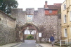 The 16th Century Priory Gate, with it's nail studded doors and inset pedestrian gate, is surmounted by a tiny house, the Porters Lodge, once occupied by the Cathedral Organist.
